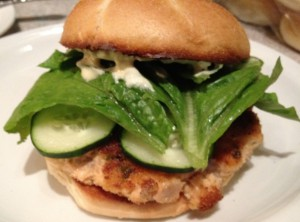 Salmon burger with cucumbers, romaine and scratch made tartar sauce