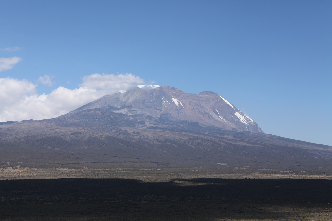 First view of Mt. Kilimanjaro across the Shira Plateau. Uhuru summit is on the right.