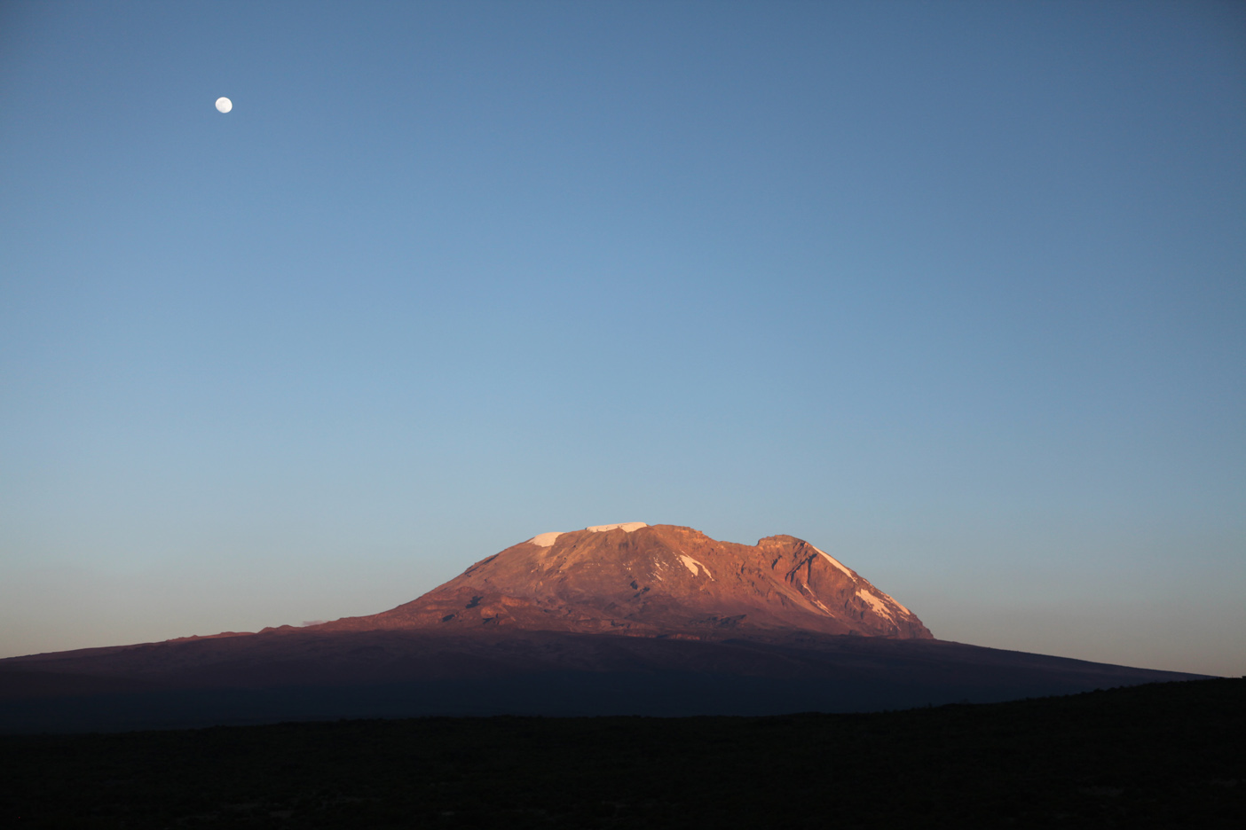 Mt. Kilimanjaro and an almost full moon at sunset from Camp 2 - Shira 1 Camp.