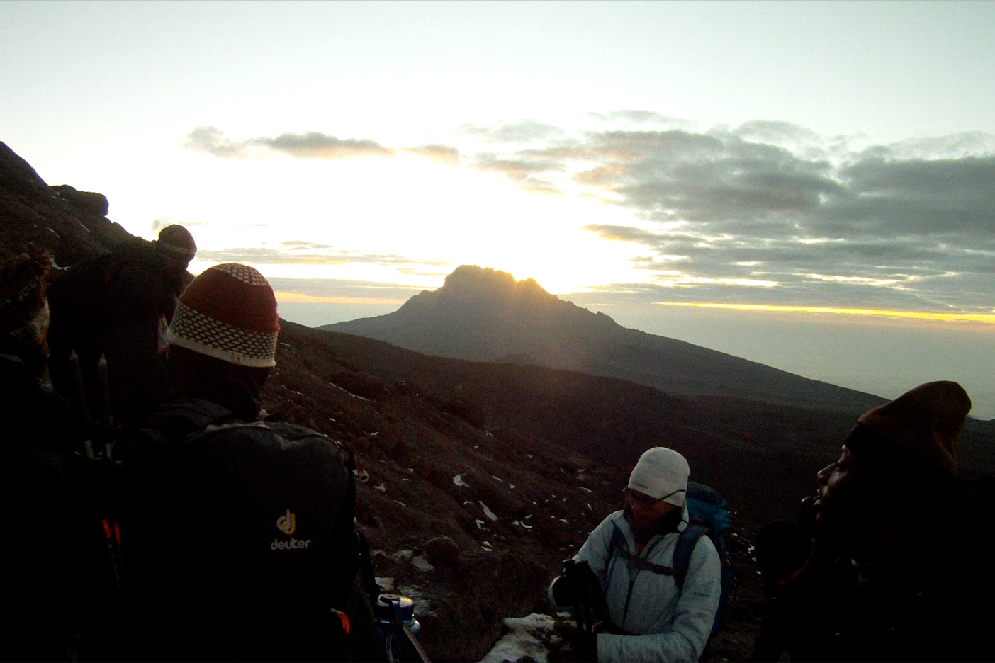 Sunrise over Mawenzi Peak with Rob (far left), Elias, John, Auston, and Roger hidden behind Gaudence (far right)