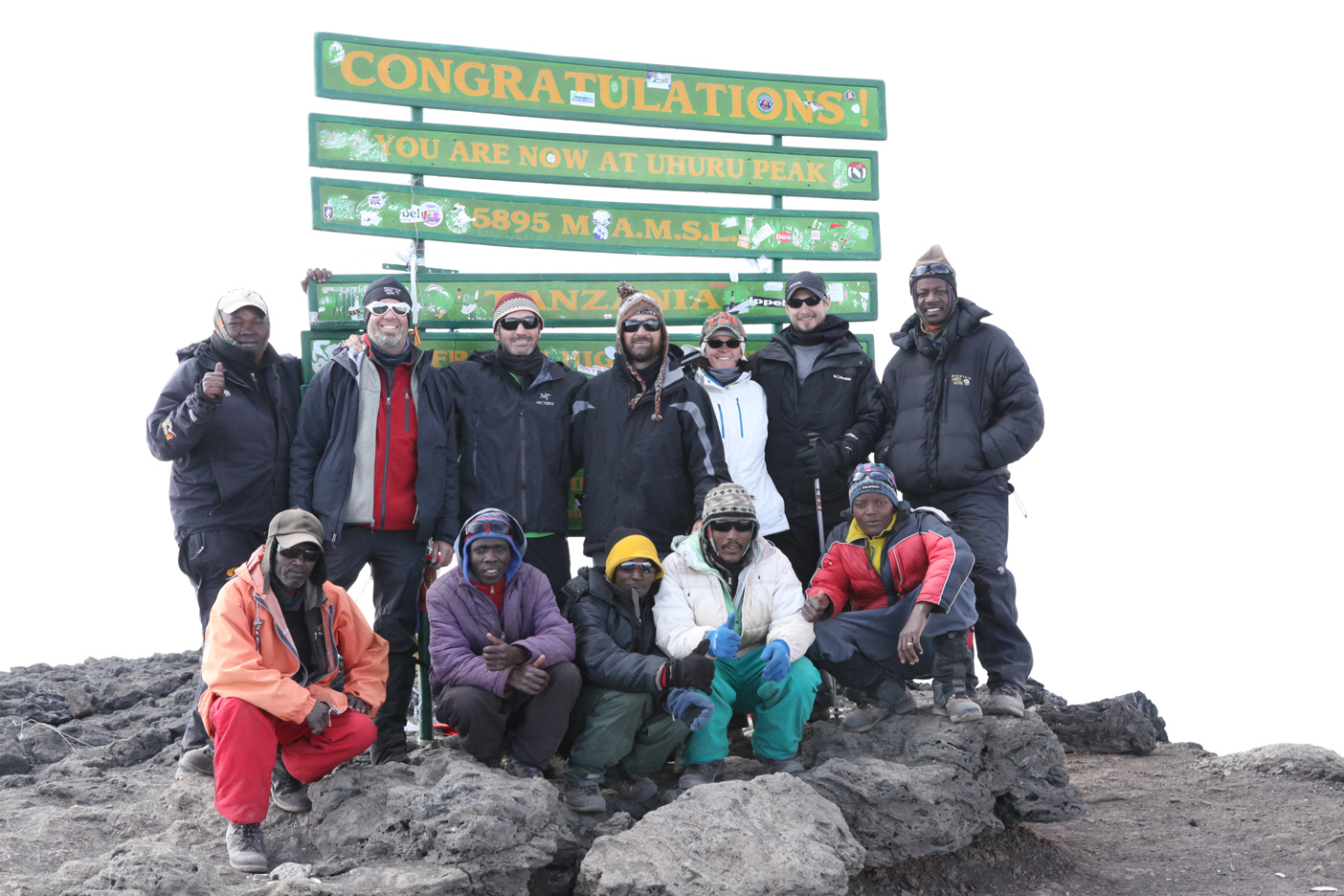 Summit team! Back row L to R: Elias (lead guide), David McDowell, John Chambers, Rob Pavone, Auston Moore, Roger Moore, Gaudence (guide); Front row L to R: Iyubu, Romo, David, Emmanuel, Pasca