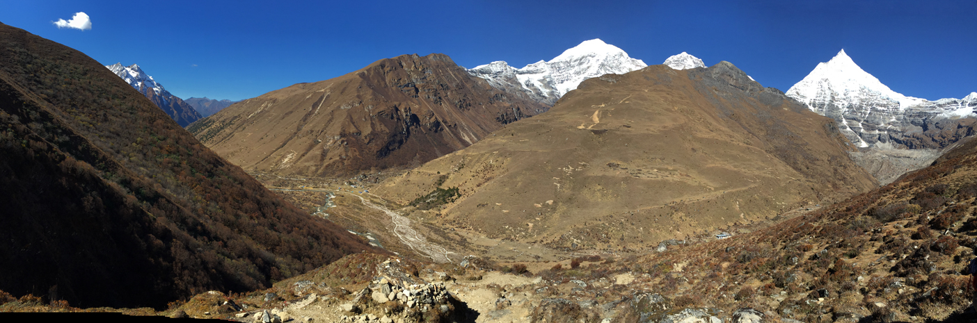 Panorama from top of ascent 1 in acclimatization hike. If you can find the tiny spec of yellow tents in lower left valley, that is Jomolhari Base Camp