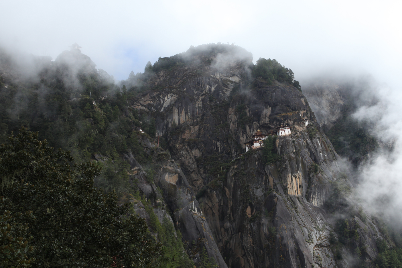 Looking up at Tiger's Nest Monastery through the morning fog