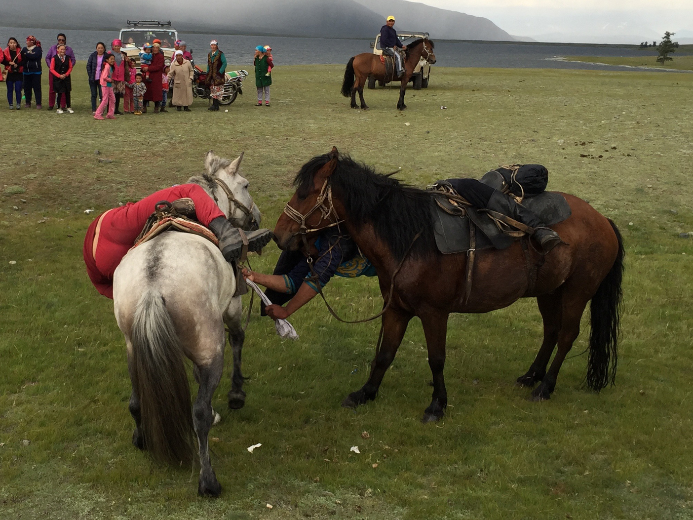 Mongolian tug of war with a rice sack while on horseback