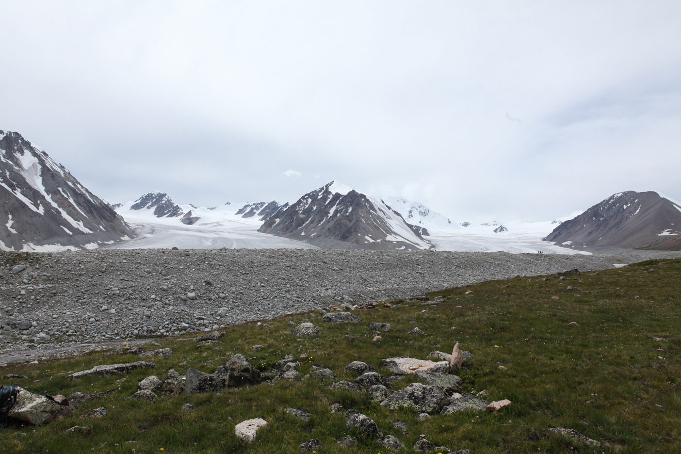 Alexander Glacier (left) and Potaniin Glacier (right); large white mountain right of center is Khüiten Peak, highest point in Mongolia at 14,350 ft. (note the 3 people in the photo for a sense of scale)